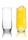 Glass of orange soda with ice cubes empty glass Royalty Free Stock Photography