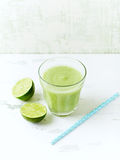 Glass of organic avocado and cucumber smoothie with lime Stock Image