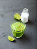 Glass of organic avocado and cucumber smoothie with lime Royalty Free Stock Photo