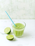 Glass of organic avocado and cucumber smoothie with lime Stock Photos