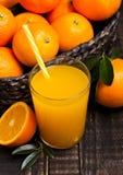 Glass of organic fresh orange juice with fruits Stock Images