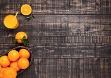 Glass of organic fresh orange juice with fruits Stock Photography