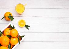 Glass of organic fresh orange juice with fruits Royalty Free Stock Photos