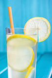 Glass of organic lemonade on wooden background Stock Images