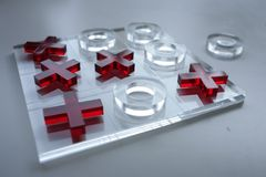 Glass oughts and crosses. Made of glass Royalty Free Stock Photo