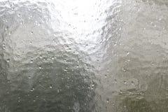 Glass pane with rain drops Stock Photos