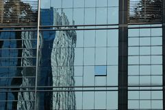 Glass panels of office building. China, modern Chinese skyscrapers close photos - visable windows, glass panels, reflections, walls Stock Images