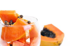 Glass with papaya on white Royalty Free Stock Images