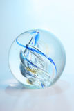 Glass Paperweight. Glass ball with blue patterns Stock Photo