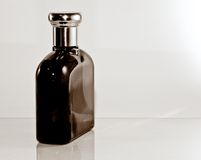 Glass parfume bottle. Stylish glass parfume bottle isolated royalty free stock photo