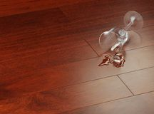 Glass on a parquet from mahogany Stock Photo