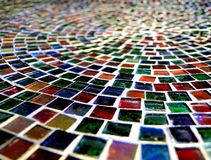 Glass Path. A beautiful platter of glass mosaic pattern. Colorful pieces of green, blue, red, amber and pink Royalty Free Stock Photos