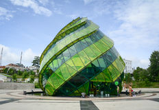 Glass Pavilion in the form of a flower bud of the artichoke in t Stock Photos