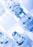 Glass pawns Stock Photo