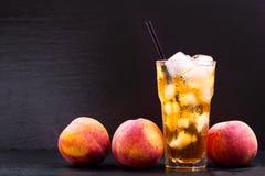 Glass of peach iced tea Stock Photo