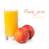 A glass of peach juice with fruits near Royalty Free Stock Image