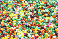 Glass pearls. The background of colored glass pearls Royalty Free Stock Photo