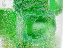 Glass of pebbles with bubbles Royalty Free Stock Image