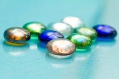 Glass pebbles macro Stock Images