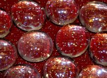 Glass Pebbles on Red Sparkle Stock Photo