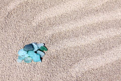 Glass pebbles on the sand Stock Images