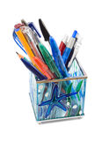 Glass pen holder with pens, isolated on white royalty free stock photo