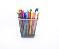 Glass with pencils. Glass with colored pencils on a white background Royalty Free Stock Images
