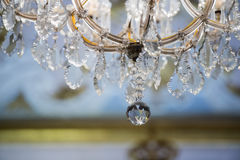 Glass pendant detail of hall chandelier Stock Photos