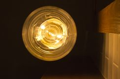 Glass pendant lamp in the form of a ball.  royalty free stock photo