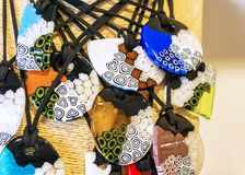 Glass pendants souvenirs from the island of Murano, Italy Stock Images