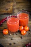 Glass peppar för tomatfruktsaft Arkivfoto