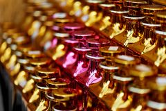 Glass perfume bottles based oils.A Bazaar, market. Macro. Gold and pink gamma Stock Photography