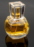 Glass of perfume Stock Images