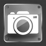 Glass photo camera icon. On a metallic background Stock Photo