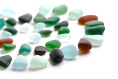 Glass pieces polished by the sea Royalty Free Stock Images