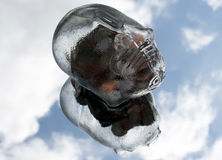 Glass Piggy Bank. Floating in the sky with a reflection in the clouds Royalty Free Stock Photography