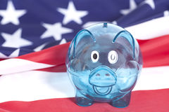 Glass Piggy bank against American national flag Royalty Free Stock Photography