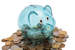 Glass Piggy Bank And Coins Royalty Free Stock Photography