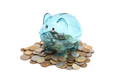 Glass Piggy Bank And Coins Royalty Free Stock Images