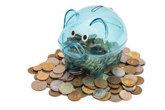Glass Piggy Bank And Coins Royalty Free Stock Photo