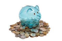 Glass Piggy Bank And Coins Royalty Free Stock Image
