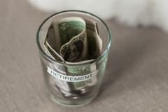 Retirement planning fund in a cup without lid Royalty Free Stock Photo