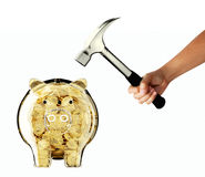 Glass Piggy bank and hammer. Glass Piggy bank and hand with hammer stock photo