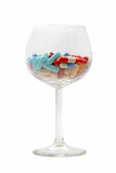Glass with pills Royalty Free Stock Photography