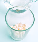Glass with pills Royalty Free Stock Photo