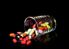 Glass of pills Stock Image