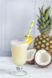 Glass of pina colada. With coconut and pineapple Royalty Free Stock Image