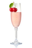 Glass of pink champagne with fresh cherry berries isolated Stock Image