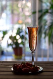 Glass of pink champagne and strawberries on a wooden table Royalty Free Stock Image