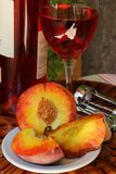 Glass of pink  wine and peaches Stock Photography